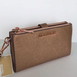 Michael Kors Jet Set rose gold double zip wallet